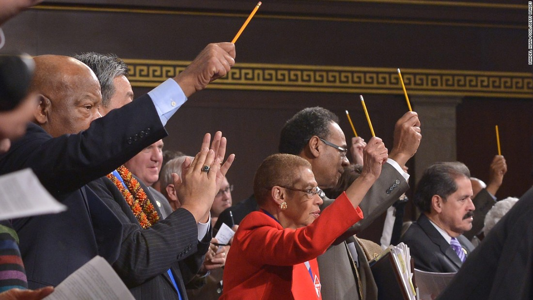 U.S. lawmakers pay tribute to the victims of the Paris terrorist attacks by holding up pencils during the speech.