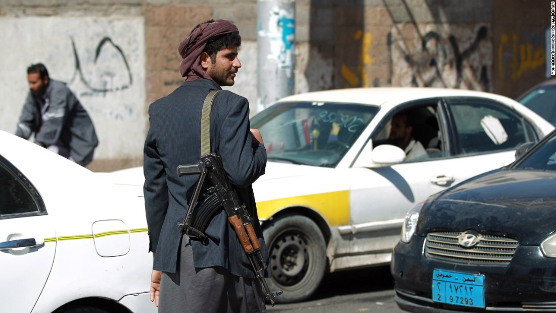 A Houthi rebel mans a checkpoint near the presidential palace on January 21.