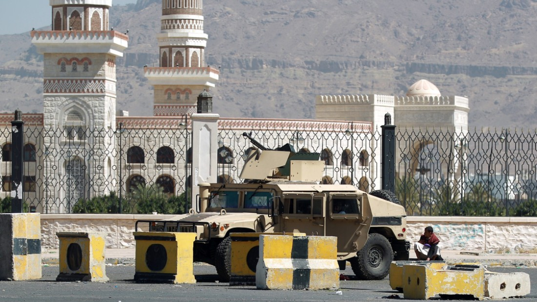 A Houthi militiaman sits near a tank near the presidential palace in Sanaa on Thursday, January 22.