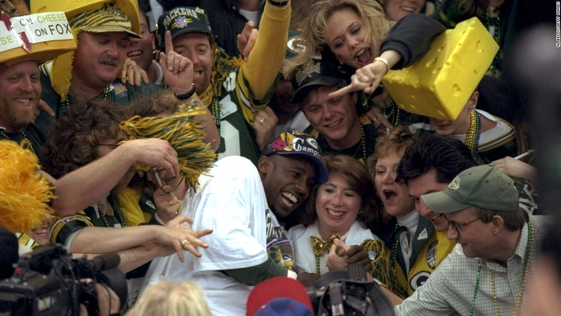 Super Bowl MVP Desmond Howard jumps into a crowd of Green Bay Packers fans after the Packers defeated New England 35-21 in Super Bowl XXXI. Howard had 244 all-purpose yards, including a 99-yard kickoff return for a touchdown.