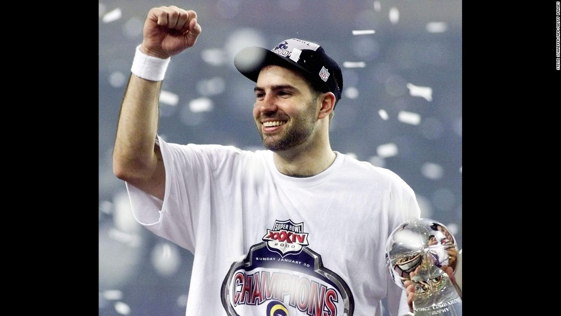 """MVP quarterback Kurt Warner celebrates after leading the St. Louis Rams to a 23-16 victory over Tennessee in Super Bowl XXXIV. Warner threw for a Super Bowl-record 414 yards, leading an offense that had been nicknamed """"The Greatest Show on Turf."""""""