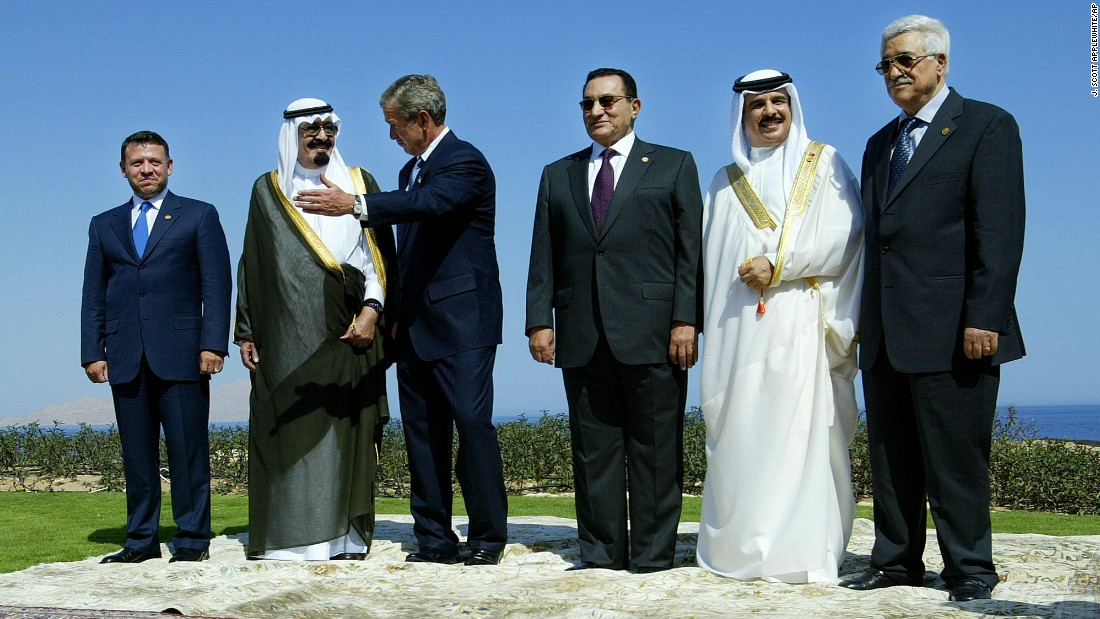 From left, Jordan King Abdullah II, Saudi Prince Abdullah, U.S. President George W. Bush, Egyptian President Hosni Mubarak, Bahrain King Hamad bin Isa Al Khalifa and Palestinian Prime Minister Mahmoud Abbas stand together for a group photo after meeting in Sharm El-Sheikh, Egypt, in June 2003.