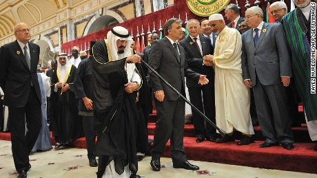 King Abdullah is escorted by Turkish President Abdullah Gul, cneter right, as Lebanese Prime Minister Najib Mikati, left, walks alongside them during a summit the Organisation of the Islamic Conference (OIC) in Mecca on August 14, 2012.