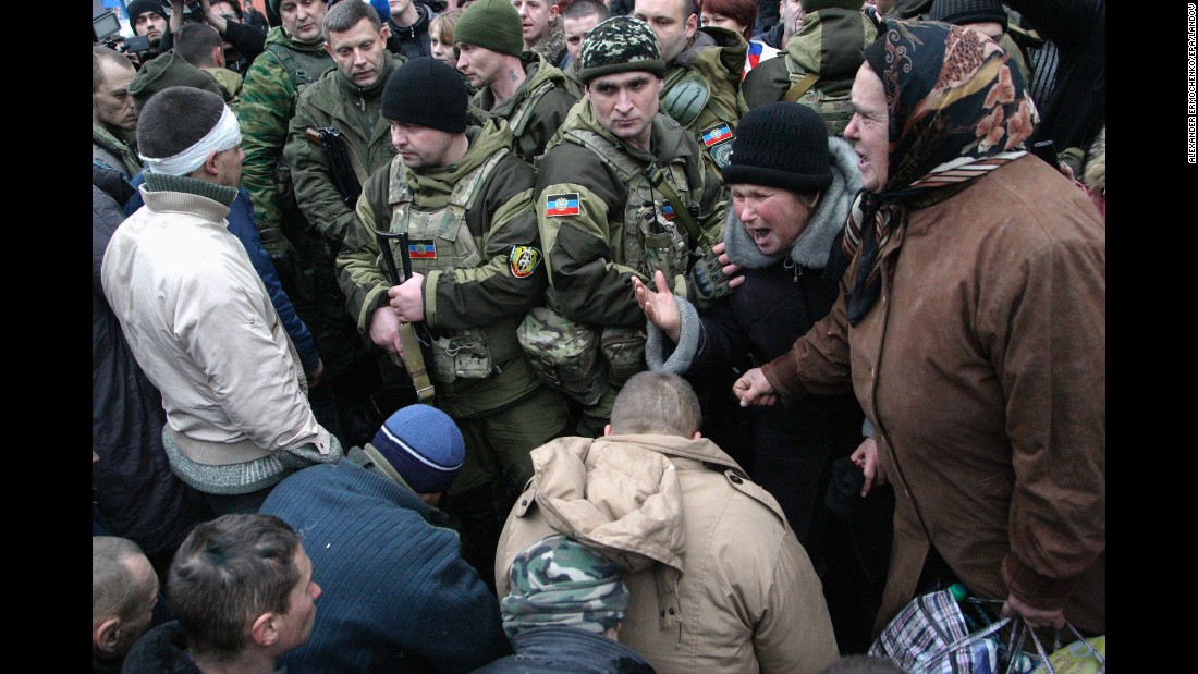 People in downtown Donetsk react as Ukrainian prisoners of war are handed over by pro-Russian rebels on January 22.