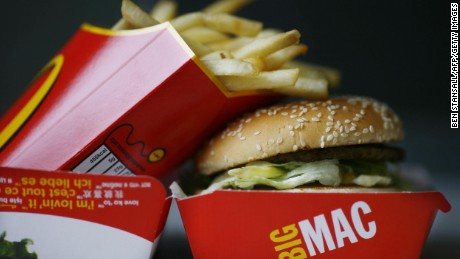 A Big Mac hamburger and french fries are pictured in a McDonalds fast food store in Central London on August 6, 2008. McDonald's launched a campaign on August 6 to recruit 4,000 staff in Britain to satisfy the demand from cash-strapped customers flocking to its restaurants as the credit crunch bites hard. As the rest of the British economy hits turbulent times, the fast food giant said it was serving an extra two million meals a month compared with this time last year. AFP PHOTO/Ben Stansall (Photo credit should read BEN STANSALL/AFP/Getty Images)