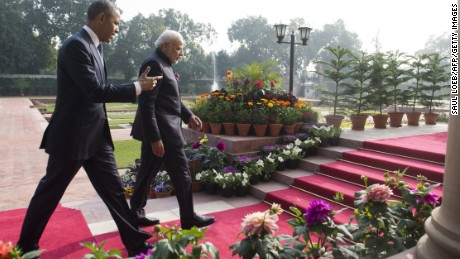 Indian Prime Minister Narendra Modi and U.S. President Barack Obama walk through gardens at Hyderabad House in New Delhi on Sunday.