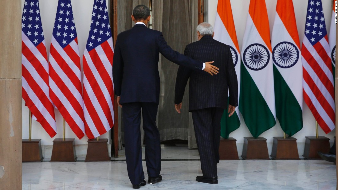 Obama and Modi walk into Hyderabad House for a meeting.