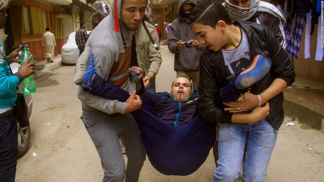 An injured protester is carried during the protests on January 25.