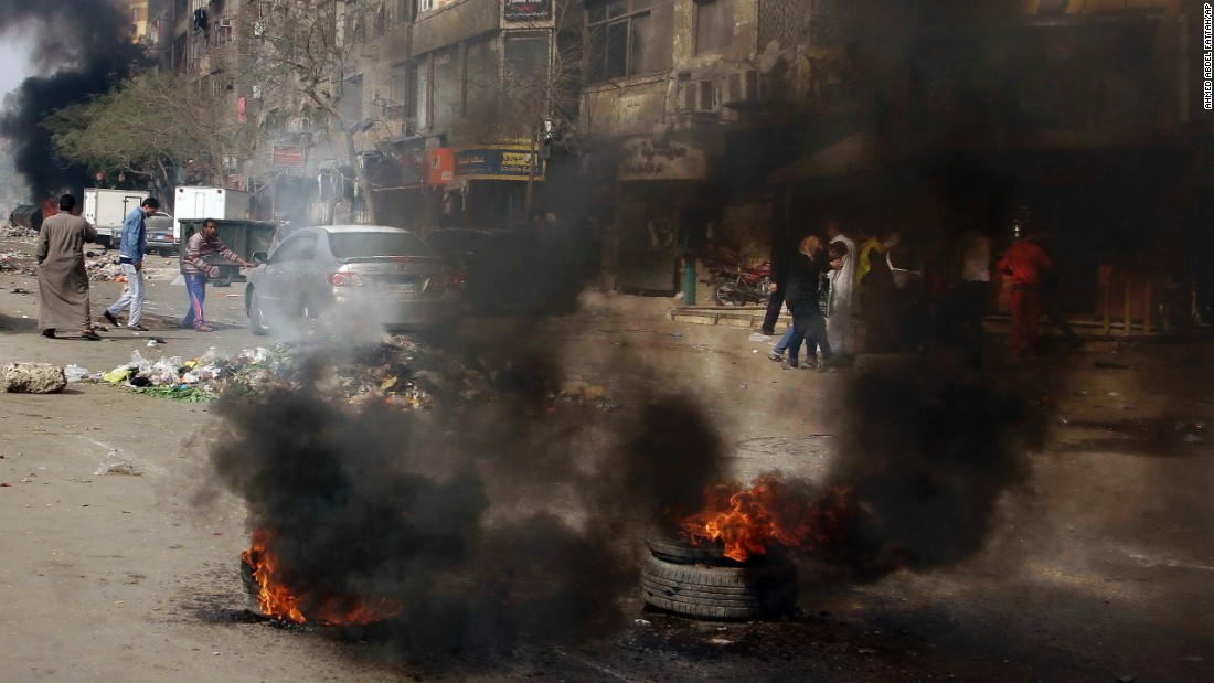 Protesters burn tires in Matariyah on January 25.