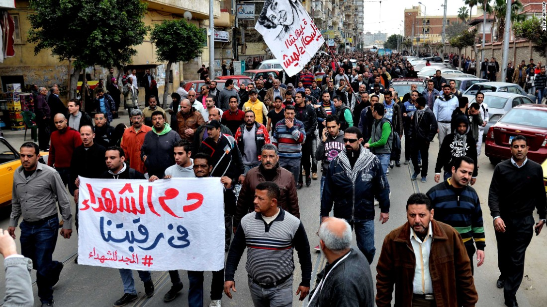 Egyptians march in the funeral procession of Shaimaa El-Sabbagh in Alexandria, Egypt, on January 25. El-Sabbagh  was shot Saturday in downtown Cairo while taking part in a gathering commemorating   protesters killed in the revolution.
