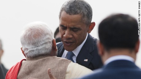 Indian Prime Minister Narendra Modi (L) hugs US President Barack Obama upon his arrival on Air Force One at Air Force Station Palam in New Delhi on January 25, 2015. Barack Obama on January 25 began an unprecedented second visit to India by a serving US president, aiming to consolidate what he has called one of the 'defining partnerships of the 21st century'. AFP PHOTO / SAUL LOEB (Photo credit should read SAUL LOEB/AFP/Getty Images)