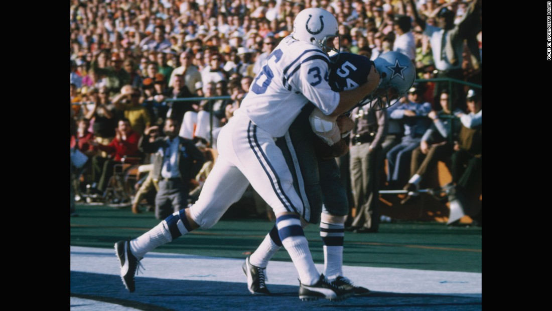 Dallas Cowboys linebacker Chuck Howley, right, holds onto one of his two interceptions against the Baltimore Colts in Super Bowl V. Howley was named the game's MVP, but the Colts won the notoriously sloppy game with a Jim O'Brien field goal as time expired. To date, Howley remains the only player from a losing team to be named Super Bowl MVP.