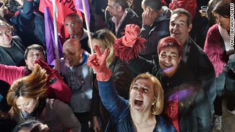 ATHENS, GREECE - JANUARY 25: Supporters of Alexis Tsipras, leader of Syriza left-wing party, cheer during a rally outside Athens University Headquarters January 25, 2015 in Athens, Greece.