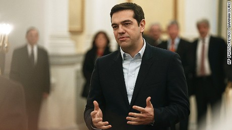 Greece's Prime Minister Alexis Tsipras, makes a secular oath to the Greek President Karolos Papoulias at the Presidential Palace in Athens, Monday, Jan. 26, 2015.