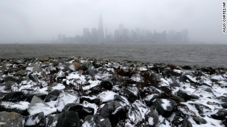 The New York skyline is seen from Liberty State Park, Monday, Jan. 26, 2015, in Jersey City, N.J. The Philadelphia-to-Boston corridor of more than 35 million people began shutting down as a monster storm, that could unload a paralyzing 1 to 3 feet of snow, moved through the northeast. (AP Photo/Julio Cortez)