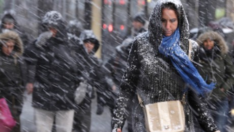 Pedestrians make their way through snow in New York, Monday, Jan. 26, 2015. More than 35 million people along the Philadelphia-to-Boston corridor rushed to get home and settle in Monday as a fearsome storm swirled in with the potential of 1 to 3 feet of snow that could paralyze the Northeast for days. (AP Photo/Seth Wenig)