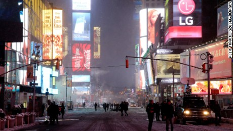 Caption:NEW YORK, NY - JANUARY 26: Pedestrians gather in Times Square following road closures on January 26, 2015 in New York City. New York, and much of the Northeast, is bracing for a major winter storm which is expected to bring blizzard conditions and 10 to 30 inches of snow to the area. (Photo by Alex Trautwig/Getty Images)