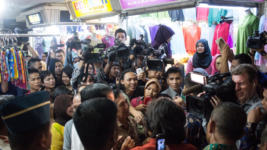 "In southeast Asia's largest garment market, narrow hallways lined with stalls became impassable as seemingly everyone in the florescent-lit building poured in for a chance to see ""Jokowi.""<br /><br />He stopped to buy 20 sarongs -- for gifts in the office, he says -- from a salesman, who struggled to contain his giddy excitement."