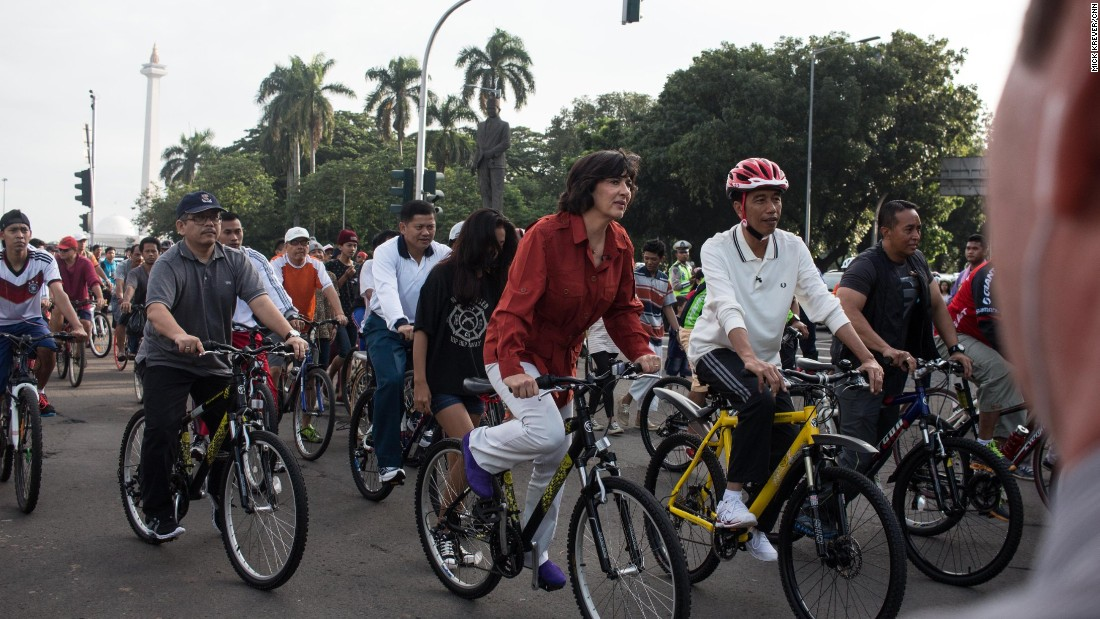 Jokowi, as he is universally known, goes out for a bike ride or other impromptu visits at least once a week.<br /><br />Here, he and Amanpour bike down a main Jakarta boulevard, which is closed off to cars every Sunday, allowing hordes of people to walk, run, and cycle free of the city's notorious traffic.