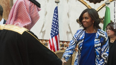 Saudi new King Salman (R), US President Barack Obama (3rd from L) and First Lady Michelle Obama (3rd from R) hold a receiving line for delegation members at the Erga Palace in the capital Riyadh on January 27, 2015. Obama is in Saudi Arabia to shore up ties with new King Salman and offer condolences after the death of his predecessor Abdullah. AFP PHOTO / SAUL LOEB        (Photo credit should read SAUL LOEB/AFP/Getty Images)