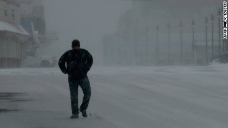 Caption:ATLANTIC CITY, NJ - JANUARY 27: A man walks along the snow covered boardwalk, on January 27, 2015 in Atlantic City, NJ. Much of the Northeast is being hit with a major winter storm that is expected to bring blizzard conditions and 10 to 24 inches of snow in some areas. (Photo by Mark Wilson/Getty Images)