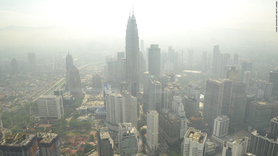 A haze has periodically wafted over Southeast Asia for 20 years. It is especially bad in the Asia-Pacific region, which has a population of over 4.2 billion and high population density. Pictured, smog hovers above the Kuala Lumpur skyline in June 2013.