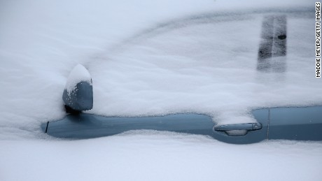 CAMBRIDGE, MA - JANUARY 27: Snow covers a car on January 27, 2015 in Cambridge, Massachusetts. Boston, and much of the Northeast, is being hit with heavy snow from Winter Storm Juno.  (Photo by Maddie Meyer/Getty Images)