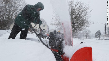 Homeowner Jonathan Spatz clears a neighbors driveway on January 27, 2015 in Old Bethpage. New York.