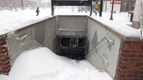 BOSTON, MA - JANUARY 27:  Snow piles up at the entrance of a closed T station is seen during the blizzard on January 27, 2015 in Boston, Massachusetts. All public transportation was shut down for the day. Twenty-six inches of snow fell on Boston by the late afternoon, and up to 33 inches in other parts of Massachusetts.  (Photo by Kayana Szymczak/Getty Images)