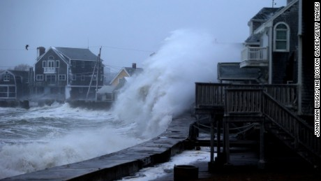 SCITUATE, MA - JANUARY 27: A wave slams into a part of the Scituate, Mass. town sea wall as an evening high tide approaches. (Photo by Jonathan Wiggs/The Boston Globe via Getty Images)