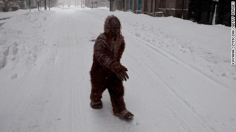 Caption:BOSTON, MA - JANUARY 27: A person dressed as 'bigfoot' makes their way through the strong wind and snow in the Back Bay neighborhood during a blizzard on January 27, 2015 in Boston, Massachusetts. Twenty-six inches of snow fell on Boston by the late afternoon, and up to 33 inches in other parts of Massachusetts. (Photo by Kayana Szymczak/Getty Images)