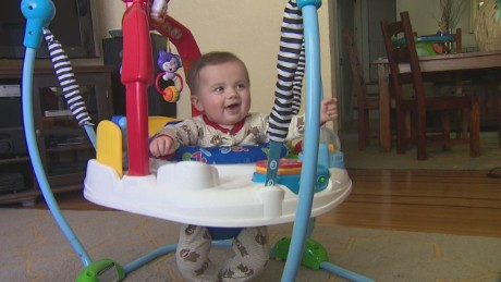 A happy baby, Livia Simon has been stuck at home because of possible exposure to an unvaccinated child.