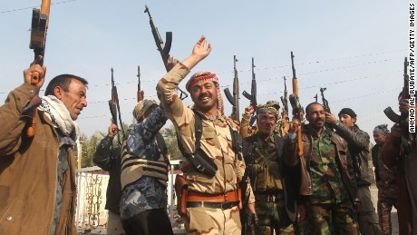"""Iraqi Sunni fighters from the Jubur tribe celebrate after defeating Islamic State group (IS) in the village of Sharween in Diyala province, northeast of Baghdad, on January 27, 2015. Iraqi forces have """"liberated"""" the province from IS group, retaking all populated areas of the eastern region, a top army officer said on January 26, 2015. The symbolic victory for Baghdad, which has at times struggled to push IS back, could clear the way for further advances against the jihadists. AFP PHOTO/AHMAD AL-RUBAYE        (Photo credit should read AHMAD AL-RUBAYE/AFP/Getty Images)"""