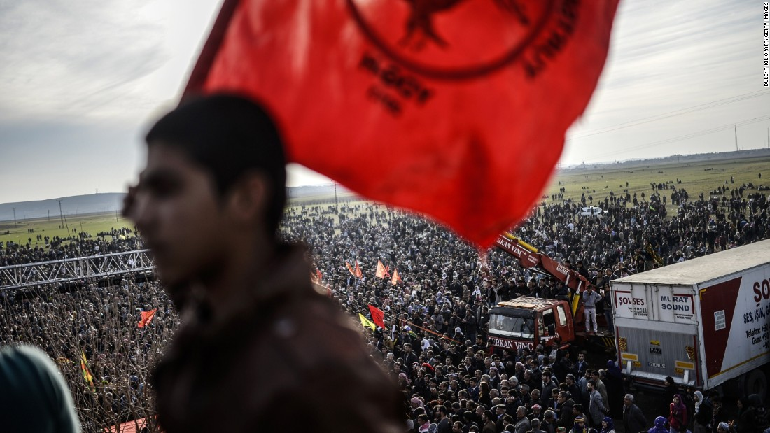 Kurdish people celebrate in Suruc, Turkey, near the Turkish-Syrian border, after ISIS militants were expelled from Kobani, Syria, on Tuesday, January 27. Kobani, also known as Ayn al-Arab, had been under assault by ISIS since mid-September.