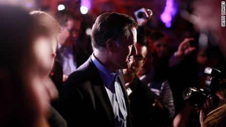 SAN DIEGO, CA - JANUARY 16: Mitt Romney is greeted by fellow Republicans at a dinner during the Republican National Committee#39;s Annual Winter Meeting aboard the USS Midway on January 16, 2015 in San Diego, California. Romney is contemplating a possible 2016 presidential run.