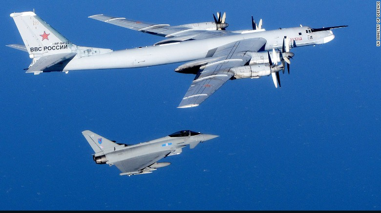 A Russian Tu-95 Bear bomber is escorted by a British Royal Air Force Typhoon fighter during an intercept in September 2014. Click through the gallery to see other intercepts in late 2014.