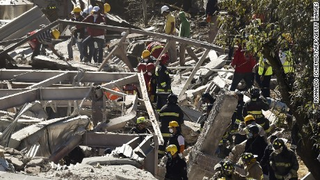 Rescuers work amid the wreckage caused by an explosion in a hospital in Cuajimalpa, Mexico City, on January 29, 2015. A gas tank truck blew up outside a children's hospital in Mexico City on Thursday, killing at least four people and injuring dozens, including 22 children, as the building partly collapsed.    AFP PHOTO/RONALDO SCHEMIDT        (Photo credit should read RONALDO SCHEMIDT/AFP/Getty Images)