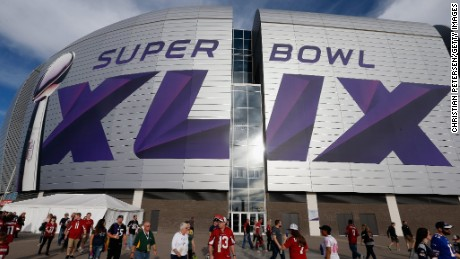 Big event - fans explore the University of Phoenix stadium in Glendale, Arizona where Super Bowl XLIX will kick off.