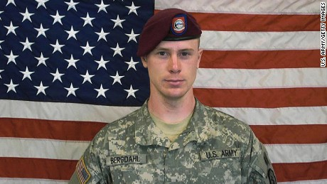 In this undated image provided by the U.S. Army, Sgt. Bowe Bergdahl poses in front of an American flag. U.S. officials say Bergdahl, the only American soldier held prisoner in Afghanistan, was exchanged for five Taliban commanders being held at Guantanamo Bay, Cuba, according to published reports. Bergdahl is in stable condition at a Berlin hospital, according to the reports. (Photo by U.S. Army via Getty Images)