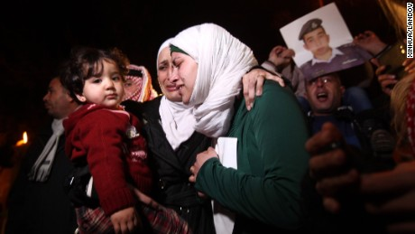 Wife of the Jordanian pilot Muath Kasasbeh who was captured by IS protests in front of Royal Palace in Amman, Jordan, on Jan. 28, 2015. The Islamic State (IS) militant group threatened to kill a Japanese hostage and Jordanian pilot within 24 hours if female suicide bomber is not released.