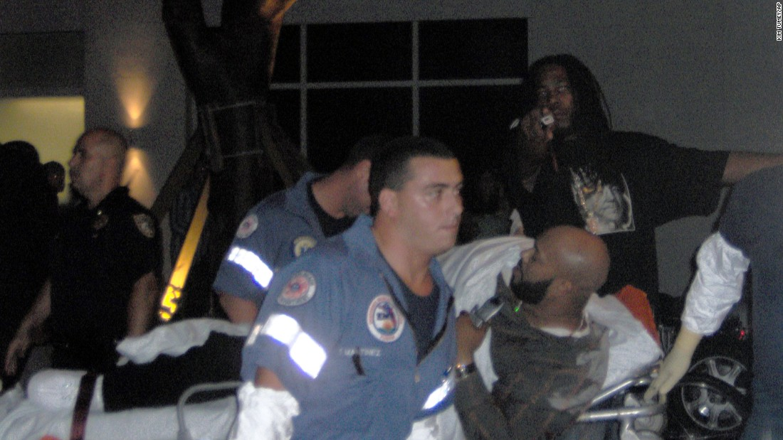 Knight is taken away by paramedics after he was shot in the leg at the Shore Club in Miami Beach, Florida, in August 2005.