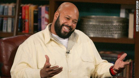 "Music Producer Suge Knight (L) and guest host D.L.Hughley appear at CBS Studios for a taping of ""The Late Late Show"" on November 18, 2004 in Los Angeles,"