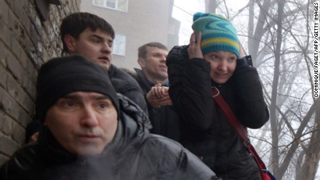 People take cover during a shelling in a residential area in Donetsk's Kyibishevsky district, on January 30, 2015.