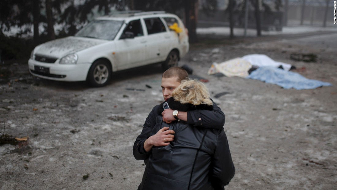 A rebel comforts the wife of a civilian killed in shelling in Donetsk on January 30. Artillery fire in the rebel stronghold of Donetsk killed at least 12 civilians that afternoon.