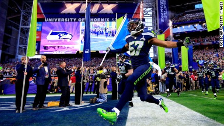 GLENDALE, AZ - FEBRUARY 01:  Mike Morgan #57 of the Seattle Seahawks runs on to the field prior to Super Bowl XLIX against the New England Patriots at University of Phoenix Stadium on February 1, 2015 in Glendale, Arizona.  (Photo by Rob Carr/Getty Images)