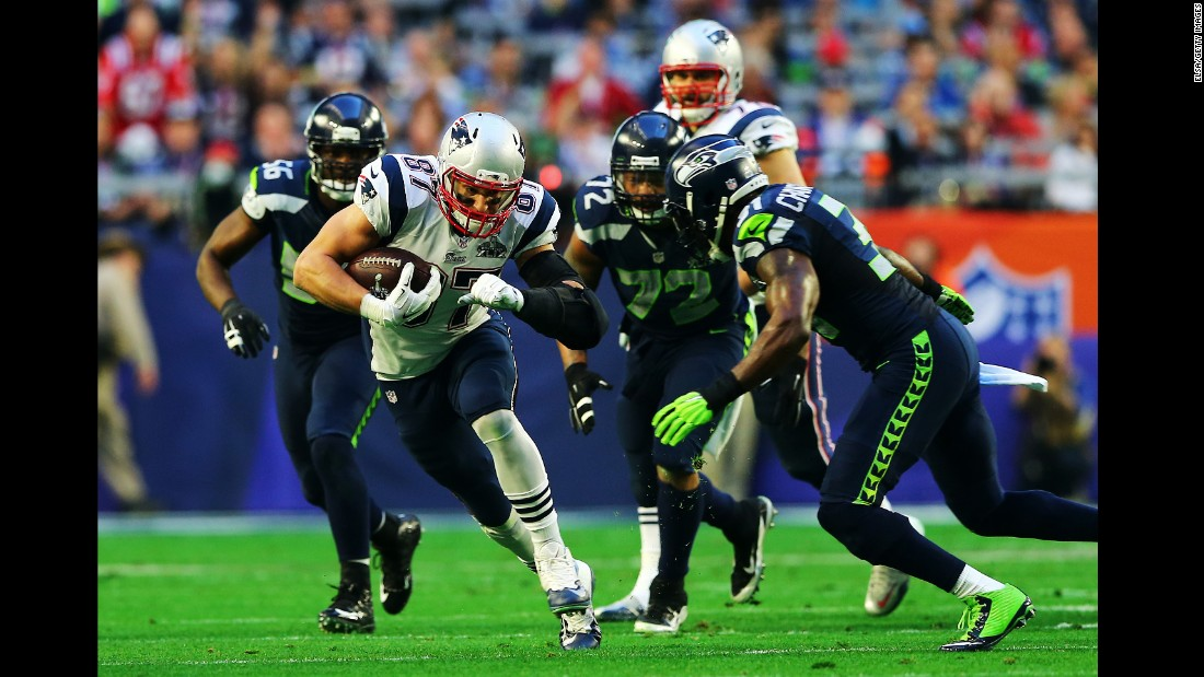 Gronkowski tries to evade Seattle defenders after a first-quarter catch.