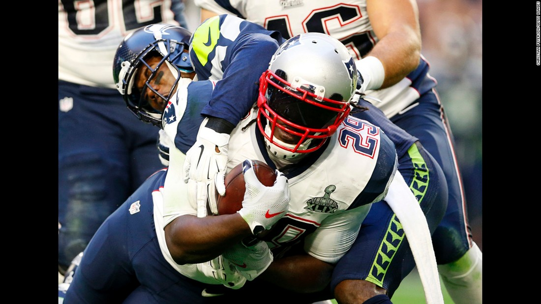 Blount carries the ball in the first half.