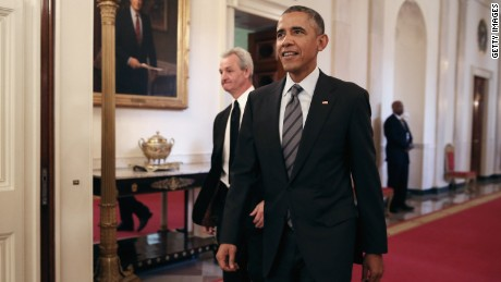President Obama walks through the White House.
