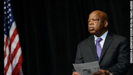 Caption:WASHINGTON, DC - AUGUST 23: John Lewis attends the U.S. Postal Service Unveiling of the 1963 March On Washington Stamp on August 23, 2013 in Washington, United States. (Photo by Riccardo S. Savi/Getty Images for U.S. Postal Service)