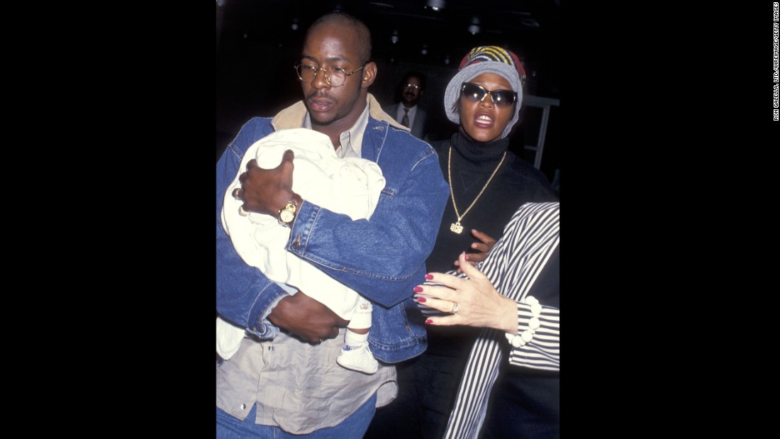 Bobby Brown, Houston and a 3-month-old Bobbi Kristina arrive at New York's Kennedy Airport in 1993.